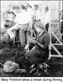 Mary Pickford takes a break during filming